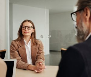 Woman Sitting in a Meeting Facing a Man